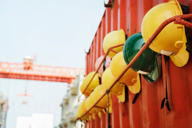 Hard hats hung in a row